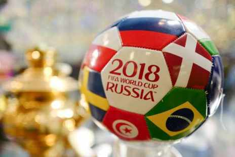 MOSCOW, RUSSIA - JUNE 12 A Russian tourism shop selling a 2018 FIFA World Cup Russia football with flags of the competing nations on it in Moscow ahead of the 2018 FIFA World Cup Russia on June 12, 2018 in Moscow, Russia. (Photo by Matthew Ashton - AMA/Getty Images)
